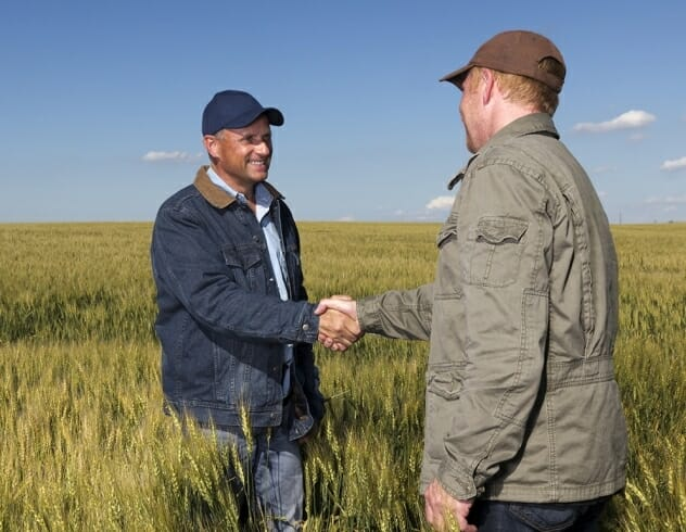 Two farmers shaking hands